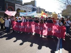 Protesters marching during world catholic youth day